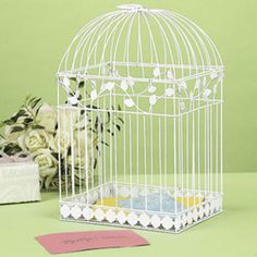 """White Birdcage Card Holder. This metal card holder is decorative and useful too! Put this White Birdcage card holder on the gift table for wedding guests to slip their cards into. Measures 16""""."""