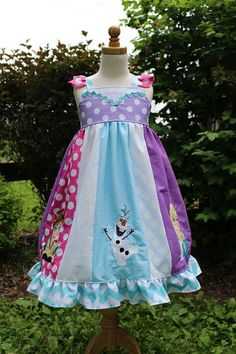 Would so buy this if it wasn't so expensive!!!Frozen inspired Dress,  Elsa, Anna and Olaf together in a themed strip Dress inspired by Disney's Frozen, sizes 2T-8girls on Etsy, $91.00