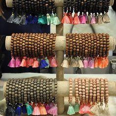 https://www.etsy.com/listing/196422632/mini-tassels-10-tiny-short-cotton?ref=shop_home_feat_2 Perfect shorty tassels for making mala-style bracelets