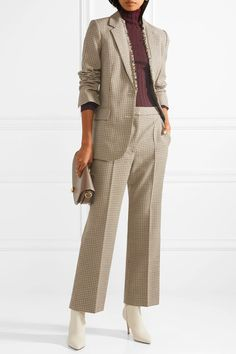 Camel, brown and black wool Button fastenings through front 100% wool; lining: 52% viscose, 48% cotton Dry clean Designer color: Hanvana Imported