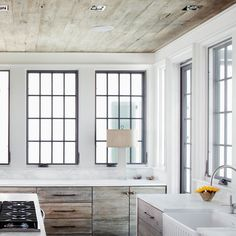 HGTV invites you to see this contemporary coastal kitchen with tons of windows and natural wood cabinets. Home Design, Design Ideas, Alys Beach Florida, Reclaimed Wood Kitchen, Modern Kitchen Cabinets, Wood Cabinets, Kitchen Ideas, Kitchen 2016, Kitchen Grey