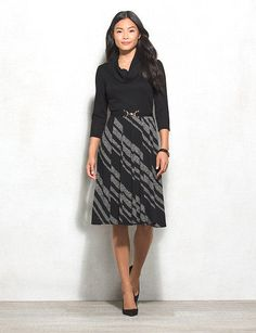 Just because sweater dresses are comfy doesn't mean they can't look completely polished. This office-approved style will have you receiving compliments left and right. Allover texture; striped pattern on skirt. Removable belt. Imported.