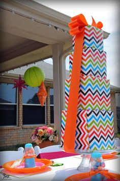 Cool centerpiece idea! Wrap a bunch of boxes and  stack them like a tiered cake!