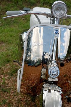 Stylish classic Vespa that screams for a guy with a suit