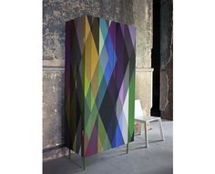 Cole and son geometric. wallpapered cabinet that is then lacquered