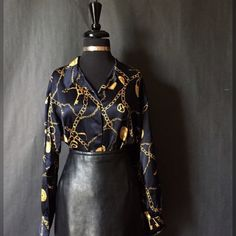 """This navy blue gold designed St. John Couture is a beautiful vintage piece to have in your collection. Not only are the designs nice, but the overall style is classy and can be worn to various occasions.    This is a genuine St. John Couture, long sleeve, button front, folded v-neck collar and navy blue with gold key and lock patterns through out.    The blouse is a size 8 with the following measurements:    Length: 27.5""""    Shoulder and Arm Length: 30.5""""    Bust: 42""""    This item ships…"""