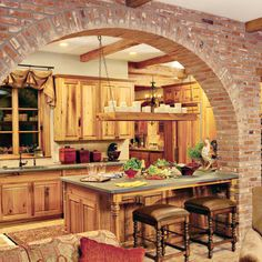 Like the arch, the natural wood, and the texture / contrast of brick inside.