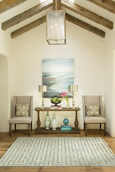 Make more of your hallway or foyer with the right sofa table and accent chairs. See more inspiring rooms. #LivingSpaces