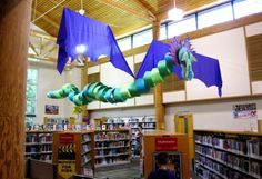 Dragon Library Display - large hanging from ceiling - paper rings and wings.