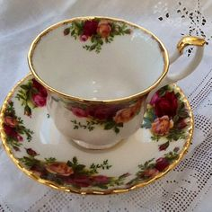 Vintage Royal Albert tea cup and saucer dated 1962 Country Roses pattern pretty floral sprays, elegant shape gilded highlights excellent