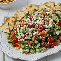 This delicious Middle Eastern Chickpea Salad will be a new favorite with chickpeas and fresh veggies tossed in a flavorful lemon basil vinaigrette