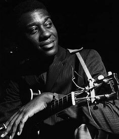 Grant Green at a Blue Note recording session, photo by Francis Wolff