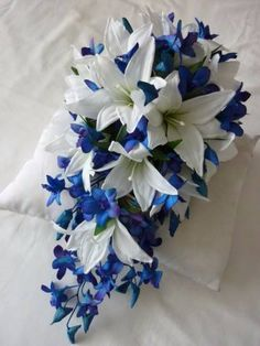 Lots of bride-to-bes may understand the wedding event flower they desire in their own bouquet, however are a little mystified about the remainder of the wedding event flowers needed to fill out the ceremony and reception. Artificial Wedding Bouquets, Cascading Wedding Bouquets, Blue Wedding Flowers, Bride Bouquets, Bridal Flowers, Lily Bouquet Wedding, Wedding Flower Guide, Wedding Ideas, Wedding Reception