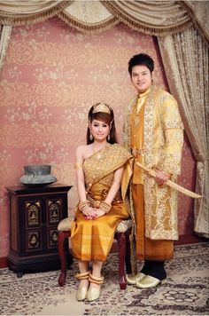 gold cambodian wedding dresses (the guy's shoes and little sword make me laugh tho!)