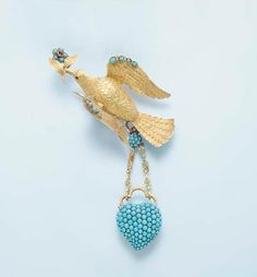 AN ANTIQUE TURQUOISE AND GOLD PENDANT BROOCH