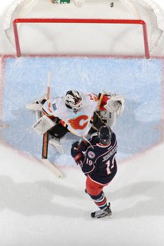 The puck goes in the net off a shot from Nick Foligno #71 as Ryan Johansen #19 shields goaltender Miikka Kiprusoff #34 of the Calgary Flames during the second period on March 22, 2013 at Nationwide Arena. (Photo by Jamie Sabau/NHLI via Getty Images)