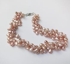 Henrietta necklace - designed by the founder of GLLAM in honor of his mother. Pink Freshwater Pearls with handmade sterling silver clasp.