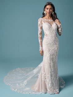 You're a goddess, and therefore deserve a gorgeous train, customizable sleeve options, and a heavenly silhouette. We present this elegant illusion lace sheath wedding dress for your consideration.