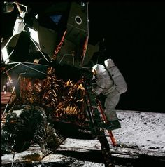 Apollo 12 lunar module pilot Alan Bean steps down to moon's surface during his 1969 flight.