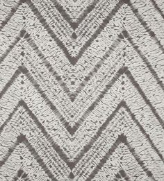 "Melaya, Dune - $19.95 per yard 54"" wide 100% Cotton A beautiful batik twist on the popular chevron stripe in a warm grey and white combo by Braemore. Pattern repeat is 13.5"" vertical by 27"" horizontal. Plain weave, upholstery weight fabric, weighs 7 oz or 200 grams per yard. Has a soil and stain resistant finish. Perfect for drapery, curtains, roman blinds, pillows, cushions, shower curtains, bedding accessories & most any home decor project. Dry clean only."