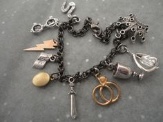 Would love this for Katie - horcrux charm bracelet