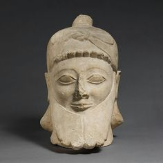 Limestone head of a bearded male wearing a conical hat. Archaic. Cypriot. First half of the 6th century B.C. | The Metropolitan Museum