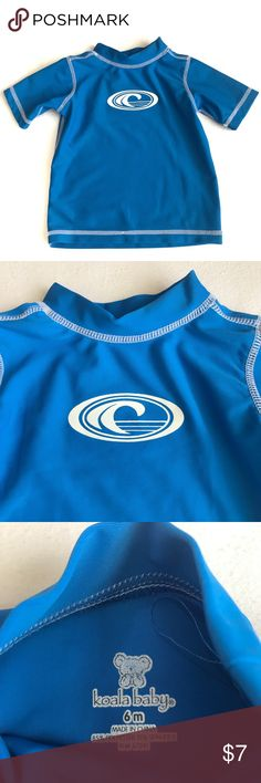 Koala Baby Rash Guard Shirt Sleeve Swim Shirt 6 Mo This short sleeve blue swim shirt has a white wave graphic on the front. Made of a polyester and spandex blend. Very good used condition from a smoke free home. Koala Kids Swim Rashguards