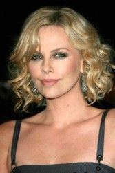 Medium Length Hair - Tousled Hairstyle:  					Easy How To Style Tips CharlizeTheron2_mrDC_505006