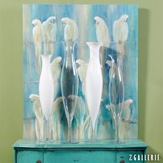 Leverage saturated hues in art to bring a splash of color to any room.