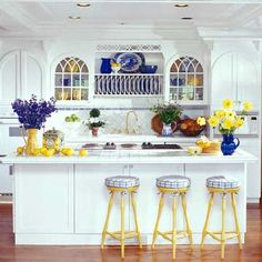 White cabinetry is a classic choice for a kitchen. Providing a neutral backdrop, white kitchen cabinets can be left alone or dressed up with colorful art and accessories. White Kitchen Cabinets, Kitchen Redo, Kitchen Living, Kitchen Remodel, Kitchen Design, Living Room, Yellow Kitchen Decor, Kitchen Colors, Home Decor Kitchen