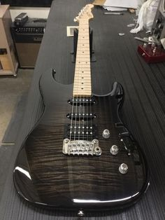 G&L Musical Instruments  Legacy Deluxe in Blackburst over flame maple on swamp ash
