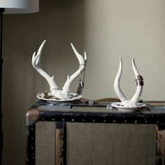 "Antler-chic and functional, this unique jewelry holder features a majestic set of deer antlers. Stack your rings or hang your favorite necklaces on the Royal Tine Deer Antler Porcelain Jewelry Holder and let your other treasured accessories rest in the convenient bottom catchall tray. With both a masculine and feminine side, the Royal Tine Deer Antler Porcelain Jewelry Holder is the perfect gift for anyone who loves innovative collections. Made of white porcelain. 7"" x 6"" x 8"" Please allow…"