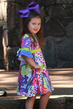 4c385f63afe Girls will love to twirl and play in this dress all day long! Fun print