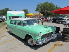 This mint green is a fave vintage car color of mine - and with a matcing travel trailer? Swoon!
