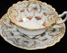 ROYAL DOULTON ANTIQUE PINK ROSES WHITE CURVY TEA CUP AND SAUCER c.1902-1922.