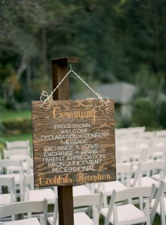 a program turned wedding sign  Photography by http://tanjalippertphotography.com, Wedding Planning by http://charmedeventsplanning.com