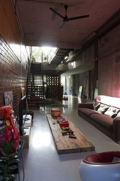Jalan Mat Jambol / Zarch Collaboratives This upscale man-cave styled loft is masculine by design...