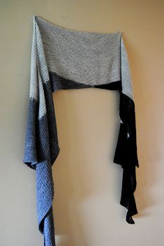 """Eris Wrap by Lisa Mutch. Wrap is """"angular, oversized, drapey and dramatic"""" according to its designer. Uses 3 colors of fingering weight yarn, and short row shaping. Wear it countless ways."""