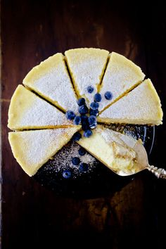 New York Style Cheesecake topped with powdered sugar and garnished with fresh blueberries!