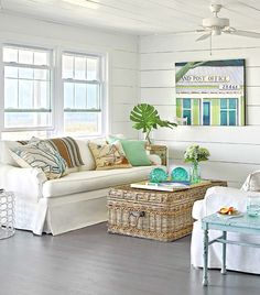 Storage Basket Coffee Table from Soft Surroundings. Featured here: http://beachblissliving.com/wicker-baskets-beach-decor/