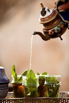 Fresh mint tea being poured, traditionally from a height, in Fes, Morocco. Try…