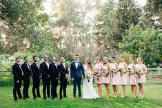 Bridesmaid in blush dresses + groomsmen in velvet suits