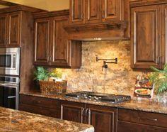 Superbe Granite Countertops With Stone Backsplash.