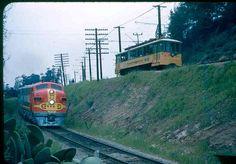 Santa Fe Chief passes Los Angeles streetcar just south of the Pasadena Station.