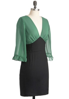 Office Envy Green Dress (ModCloth, $59.99)    Shell: 100% Polyester. Lining: 100% Polyester. Contrast: 97% Cotton, 3% Spandex.  Fabric provides stretch.  Hand wash cold, separately. Do not bleach. Hang to dry.  Lined through top. Hidden side zipper. Ties at waist.  Imported