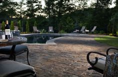 A pool deck can be a space for entertaining even if it's too chilly for a dip. Open a bottle of wine and enjoy!