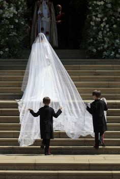 While there wasn't a maid of honor in the royal wedding of Meghan Markle and Prince Harry, the couple chose several adorable children to be bridesmaids and page boys, including Princess Charlotte and Prince George. Prince Harry Wedding, Harry And Meghan Wedding, Prince Harry And Megan, Royal Wedding Gowns, Royal Weddings, Wedding Veil, Wedding Dresses, Wedding Ceremony, Princess Meghan