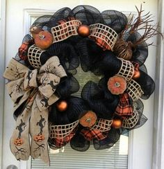 Halloween wreath in blacks and oranges