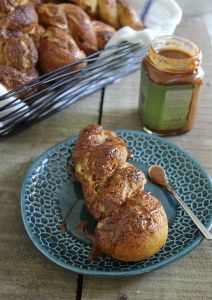 These apple cinnamon pretzel twists are drizzled in caramel sauce for a delicious fall treat.