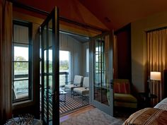 On HGTV. Love It!!! Master bedroom Porch:A wall of windows and French doors leads out to the master suite's private balcony, a space ideal for small gatherings or times of quiet reflection.